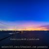 工場へと伸びる海の上の電柱日没後の風景〜東京湾の干潟の景色!人気のスポット遠浅の海岸